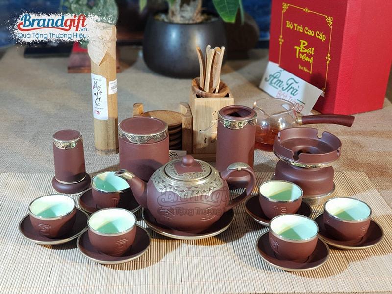 bộ ấm chén uống trà Tử Sa bọc đồng